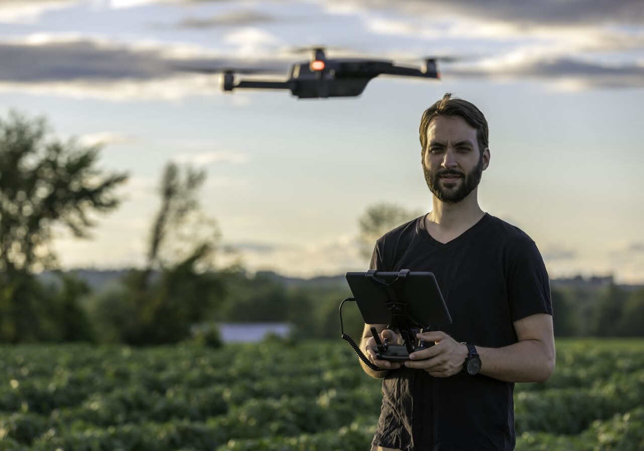 man operating commercial drone in ontario